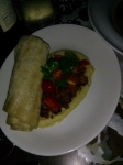 """Dried Fava Bean Puree. House Chorizo, Cherry Tomato, Parsley, Grilled Flatbread $12. We were all a little hesitant when we saw the big flatbread """"roll-up""""...but one bite and were hooked!"""